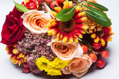 Autumn wedding bouquet close up with flowers and berries. Stock Photos