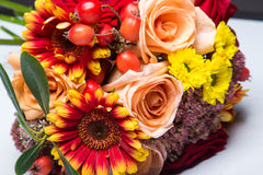 Autumn wedding bouquet close up with flowers and berries. Royalty Free Stock Photos