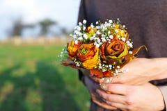 Autumn wedding bouquet in hands Stock Images