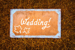 Autumn wedding wooden sign on the grass Stock Photo