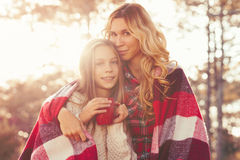 Autumn weekend. Mom and her 9 years old daughter spending weekend in the autumn forest together. Mother and child relations Royalty Free Stock Photo