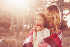 Autumn weekend. Mom and her 9 years old daughter spending weekend in the autumn forest together. Mother and child relations Stock Photos