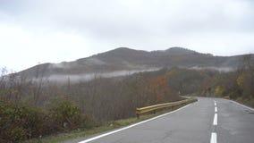 Autumn. Wet mountain road stock footage