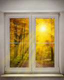 Autumn window. Sun rays in autmn leaves Royalty Free Stock Photos