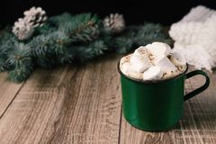 Autumn and winter hot drinks. Ideas for Christmas, Thanksgiving, Halloween. Cup with hot spicy cappuccino, with marshmallow and ci. Nnamon. Cozy, sweater, on a royalty free stock image