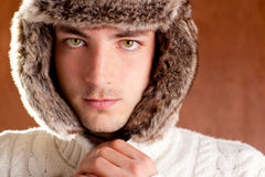 Autumn winter man with brown fur cup hat. Autumn winter man with brown fur  hat portrait Royalty Free Stock Photography