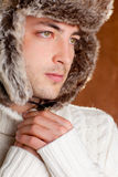 Autumn winter man with brown fur cup hat Royalty Free Stock Images