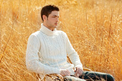 Autumn winter man portrait in outdoor dried grass Royalty Free Stock Photos