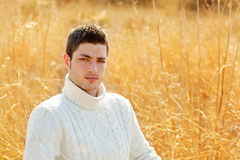 Autumn winter man portrait in outdoor dried grass Royalty Free Stock Image