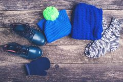 Autumn or winter outfit. Boy`s fashion clothes and accessories on wooden background. Autumn or winter outfit. Boy`s fashion clothes and accessories on the Royalty Free Stock Photography