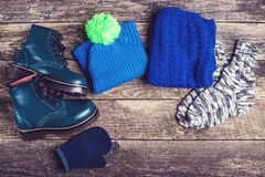 Autumn or winter outfit. Boy`s fashion clothes and accessories on wooden background. Autumn or winter outfit. Boy`s fashion clothes and accessories on the Stock Photography