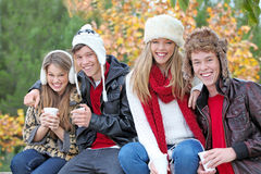 Autumn winter people. Happy autumn or fall group of smiling teens Royalty Free Stock Photos