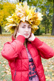 Autumn woman. The young women posing in the park Royalty Free Stock Photos