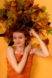 Autumn woman. Beautiful young woman with dreadlocks in autumn yellow leaves Stock Photo