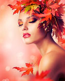 Autumn Woman. Beautiful Autumn Woman with Leaves. Fashion Art Concept Stock Image