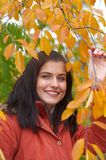 Autumn woman. Pretty girl and golden leaf Royalty Free Stock Photo