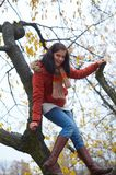 Autumn woman. Pretty and happy autumn girl Royalty Free Stock Image