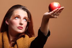 Autumn woman apple fashion female eye-lashes Royalty Free Stock Photo