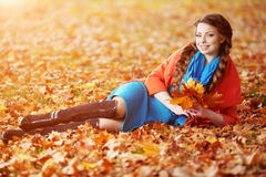 Autumn woman on background fall landscape leaves of trees. Girl Stock Photos