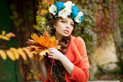 Autumn woman on background fall landscape leaves of trees. Girl Stock Photo
