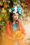 Autumn woman on background fall landscape leaves of trees. Girl Royalty Free Stock Image