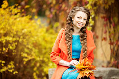 Autumn woman on background fall landscape leaves of trees. Girl Stock Photography
