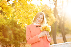 Autumn woman on background fall landscape leaves of trees. Model Royalty Free Stock Photography