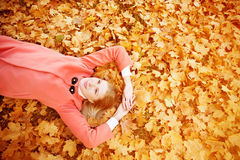 Autumn woman on background fall landscape leaves of trees. Model Stock Photo