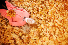 Autumn woman on background fall landscape leaves of trees. Model Stock Photography