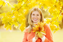 Autumn woman on background fall landscape leaves of trees. Model Royalty Free Stock Photos