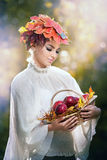Autumn Woman. Beautiful creative makeup and hair style in outdoor shoot. Beauty Fashion Model Girl with Autumnal Make up and Hair Stock Images