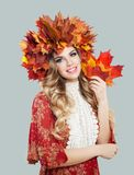 Autumn woman. Beautiful model in autumn leaves crown.  stock photos