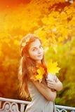 Autumn woman. Beautiful young girl in autumn park Stock Photos