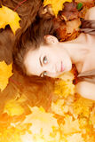 Autumn woman. Beautiful young girl in autumn park Royalty Free Stock Image