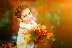 Autumn woman. Beautiful young girl in autumn park Royalty Free Stock Photos