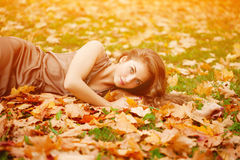 Autumn woman. Beautiful young girl in autumn park Stock Photo