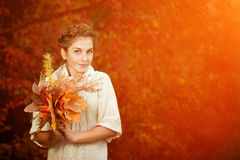 Autumn woman. Beautiful young girl in autumn park Royalty Free Stock Photography