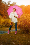 Autumn woman. Beautiful young girl in autumn park Stock Images