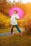 Autumn woman. Beautiful young girl in autumn park Stock Image