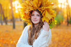 Autumn Woman. Blonde Girl and Yellow Leaves Royalty Free Stock Photography