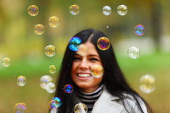 Autumn woman blow bubbles Royalty Free Stock Images