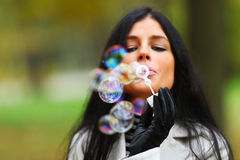 Autumn woman blow bubbles Stock Photography