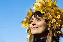 Autumn woman on blue Stock Images