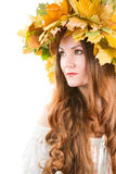 Autumn woman with crown of fall maple leaves Stock Photography