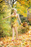 Autumn, woman in dress with leafs. October. Autumn, woman in dress with leafs Royalty Free Stock Photography