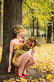 Autumn, woman in dress with leafs. October. Outdoor. Autumn, woman in dress with leafs. October Stock Photos