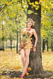 Autumn, woman in dress with leafs in park. October, Royalty Free Stock Image