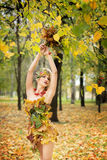 Autumn, woman in dress with leafs in park. October, Royalty Free Stock Photography