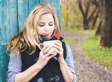 Autumn woman drinking coffee. Stock Photo
