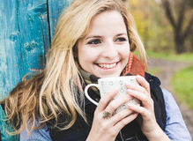 Autumn woman drinking coffee. Royalty Free Stock Photography